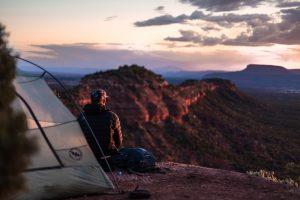 overnight camper looks at scenary