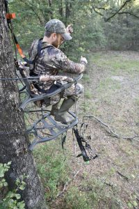 Bow hunting sitting on a seat cushion