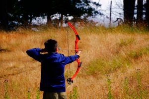 Shooting a well waxed bow string