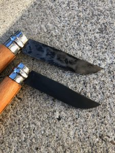 Two carbon steel blades with blue patina