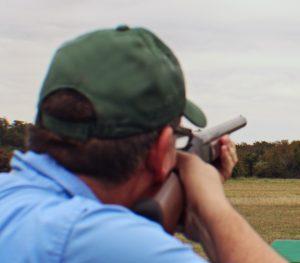 Hunter aiming shotgun with open sights