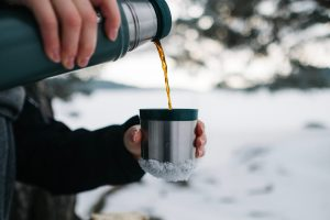 Thermos keeping coffee hot while hunting